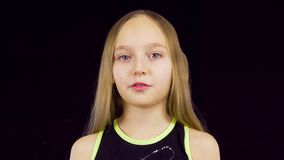 Beautiful young girl speaking than turning around stock video