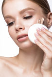 Beautiful young girl with sponge for application make-up and French manicure. Beauty face. Stock Images