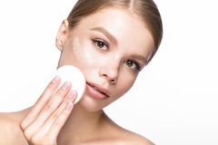 Beautiful young girl with sponge for application make-up and French manicure. Beauty face. Stock Image
