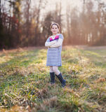 Beautiful young girl standing in a field. Beautiful young girl standing in an open field Royalty Free Stock Photos