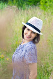 Beautiful young girl in straw hat Stock Photography