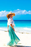 Beautiful young girl in a straw hat on a tropical beach Royalty Free Stock Images