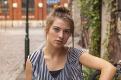 Beautiful young girl on the street of the old town. Royalty Free Stock Photos