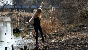 Beautiful young girl on the stumps Royalty Free Stock Photo