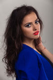 Beautiful young girl in stylish image on a dark background Stock Image
