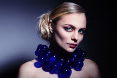 Beautiful young girl with stylish make-up, prom hairdo and fancy Royalty Free Stock Photo