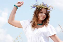 Beautiful young girl in summer field Royalty Free Stock Photography