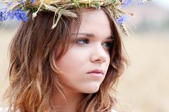 Beautiful young girl in summer field Royalty Free Stock Photo