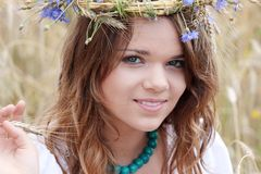Beautiful young girl in summer field Royalty Free Stock Photos