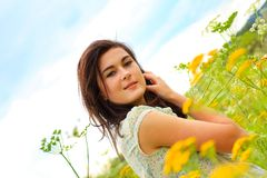 Beautiful young girl in summer fields Stock Photography
