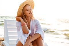 Beautiful young girl in summer hat resting. At the beach Royalty Free Stock Photos