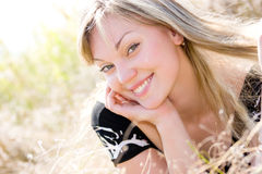 Beautiful young girl on summer meadow Royalty Free Stock Images