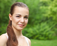 Beautiful young girl in summer park Royalty Free Stock Images