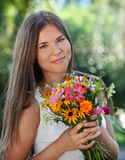 Beautiful young girl in summer park Stock Image
