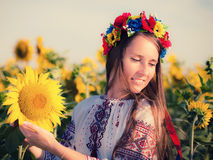 Beautiful young girl at sunflower field Stock Image