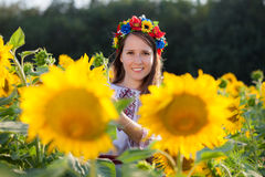 Beautiful young girl at sunflower field Stock Photos