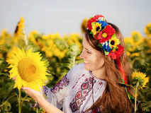 Beautiful young girl at sunflower field Stock Photo