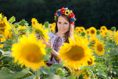 Beautiful young girl at sunflower field Royalty Free Stock Photography