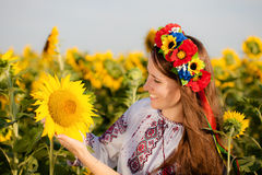 Beautiful young girl at sunflower field Royalty Free Stock Photos