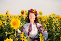 Beautiful young girl at sunflower field Royalty Free Stock Images