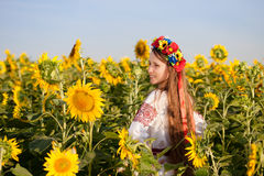 Beautiful young girl at sunflower field royalty free stock photo