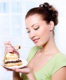 Beautiful young girl with sweet cake stock photos