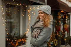 Beautiful young girl with a sweet smile in a fashionable gray.  stock images