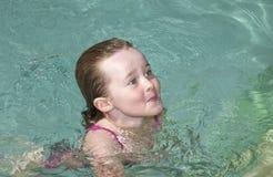 Beautiful young girl swimming Stock Photo