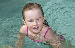Beautiful young girl swimming Stock Images