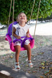Beautiful young girl on a swing Royalty Free Stock Photography