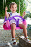 Beautiful young girl on a swing Royalty Free Stock Image
