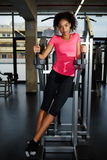 Beautiful young girl t-shirt looking to the camera during her fitness training at gym stock photography