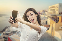 Beautiful young girl taking a selfie. Beautiful woman taking picture of herself, selfie . Pretty mixed race woman taking a selfie, Beautiful young girl taking a Royalty Free Stock Photo