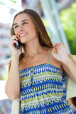 Beautiful young girl talking on mobile phone in th Stock Image