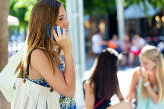 Beautiful young girl talking on mobile phone in th Royalty Free Stock Photo