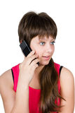 Beautiful young girl talking on a phone. isolated on white backg Stock Photography