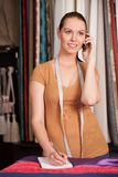 Beautiful young girl talking on phone. Stock Photography