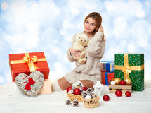 Beautiful young girl with teddy bear and gift box Royalty Free Stock Photo
