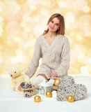 Beautiful young girl with teddy bear toy on yellow bokeh  background - romantic holiday concept Royalty Free Stock Image