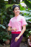 Beautiful young girl with thai traditional dress portrait Stock Photo