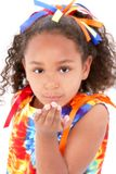 Beautiful Young Girl In Tie Die Outfit Blowing A Kiss stock photography