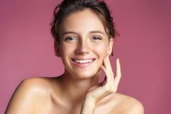 Beautiful young girl touching her perfect skin royalty free stock photo