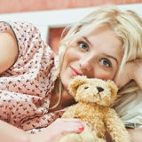 Beautiful young girl with toy Stock Photography