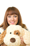 Beautiful young girl with toy dog Royalty Free Stock Images
