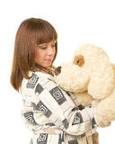Beautiful young girl with toy dog Stock Images