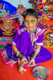 Beautiful young girl with traditional embroydered costume Royalty Free Stock Image