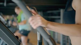 Beautiful young girl is training on muscle sexy quality and strong slim body. Health people activity and fitness athletic club for cardio exercise. Workout stock footage