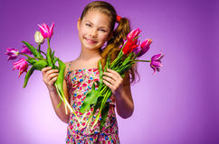 Beautiful young girl with tulips Royalty Free Stock Image