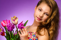 Beautiful young girl with tulips Royalty Free Stock Photography