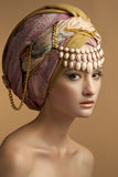 The beautiful young girl in a turban Stock Image